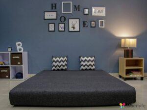 black sofa cum bed with pillows (2)